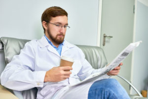 Doctor Reading the Newspaper